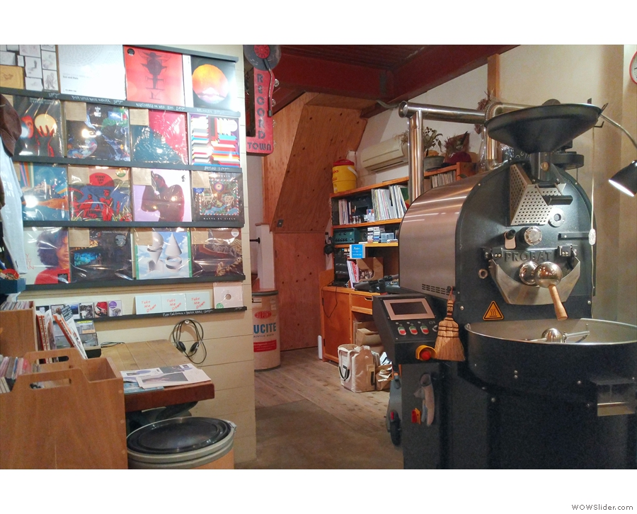 At the back is the roaster, located at the end of the counter.