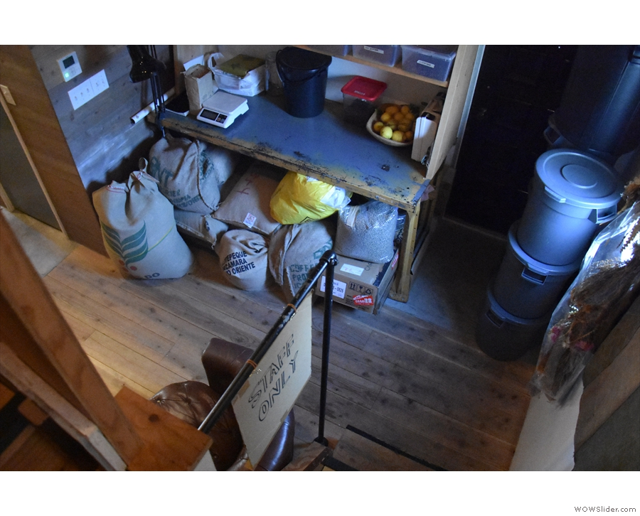 The roastery, seen from the stairs at the back. Green beans are stored under the table...
