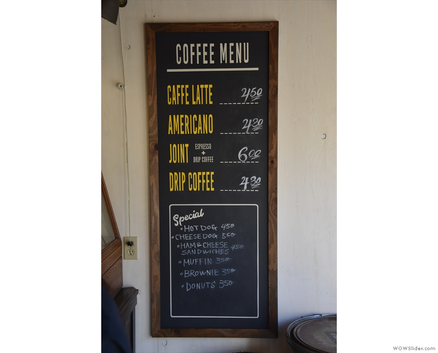 A cut-down coffee menu (plus food) is on the wall to the right...