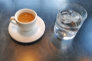 ... as well as an espresso or two, always served with a glass of water.