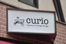 ... Curio Espresso and Vintage Design. Nice sign, by the way.