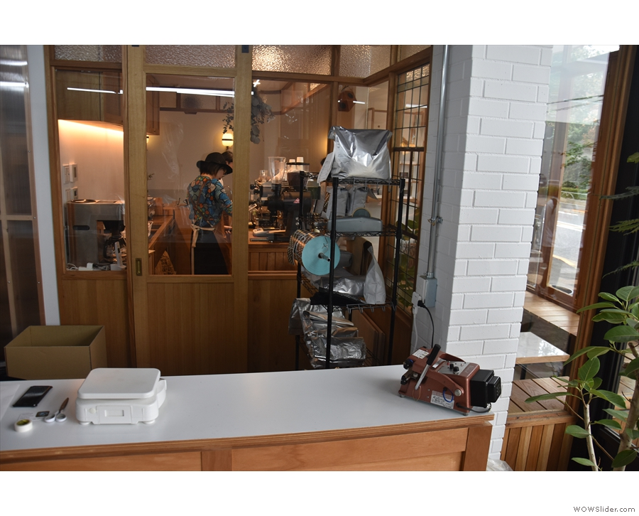 You can see into the coffee shop through the windows behind the counter.
