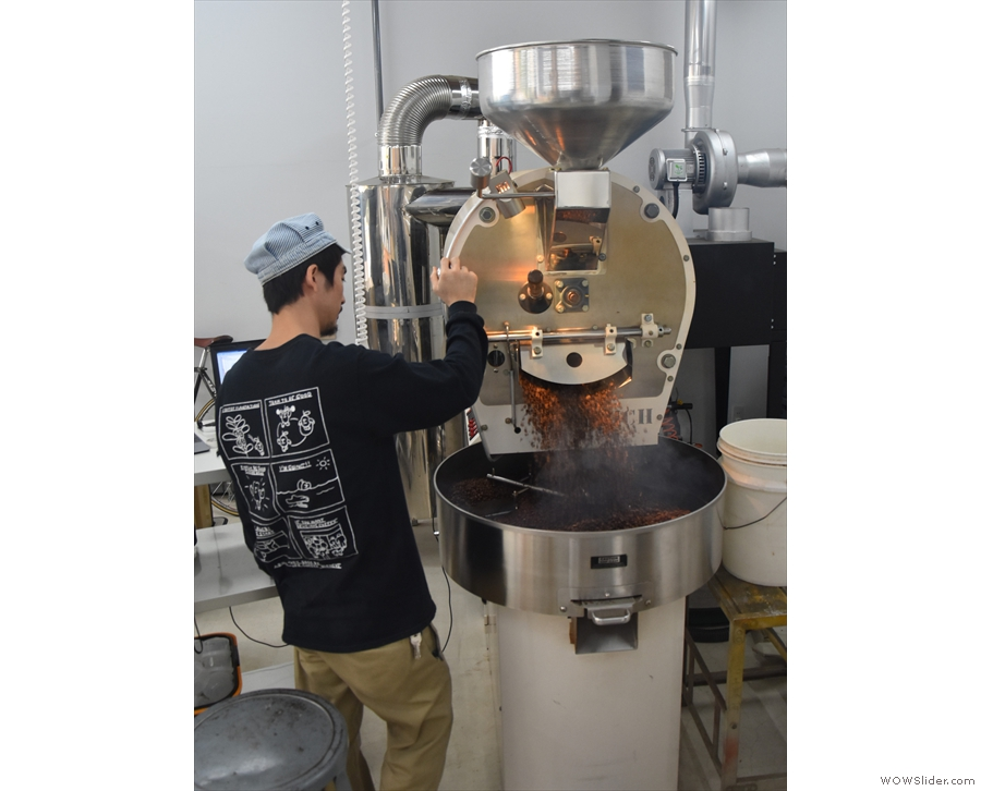 ... and then Yohei opens the flap at the bottom of the roaster...