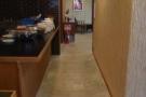 A long, narrow corridor runs down past the kitchen...