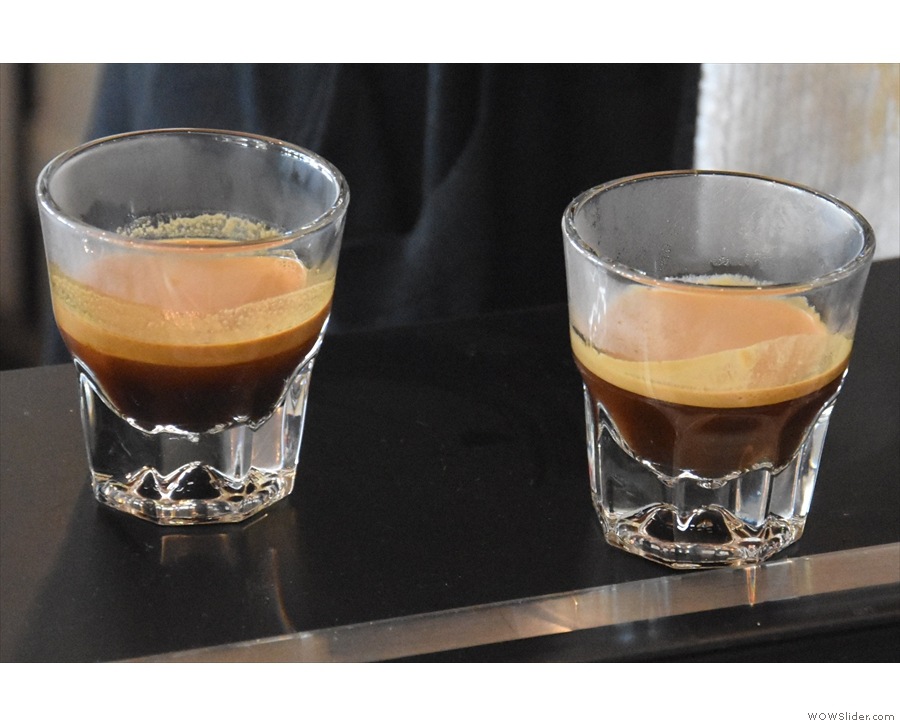 The two finished espressos, waiting for their milk.