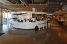Madcap occupies this circular island counter off to the left of the doors, with the rest of...
