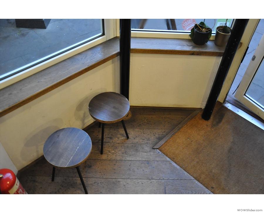 The stools by the door.