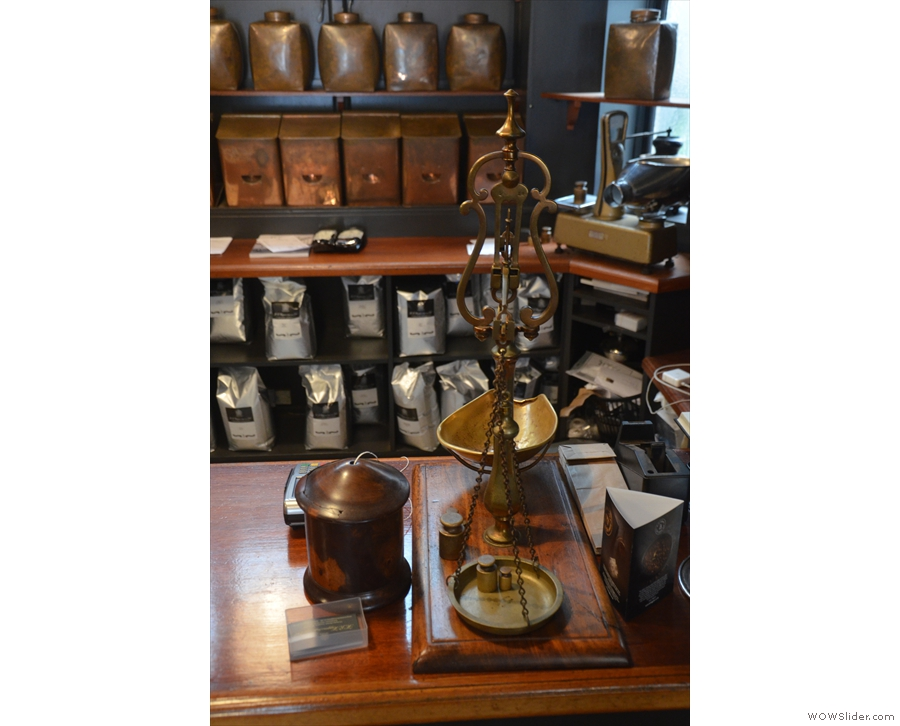 ... the beans weighed out using these equally old-fashioned scales.