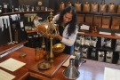 After all this, I had to have some coffee. This is Preethi, the manager, weighing out some...
