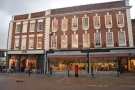 On the eastern side of Worcester's Cornmarket stands this row of three-storey buildings...