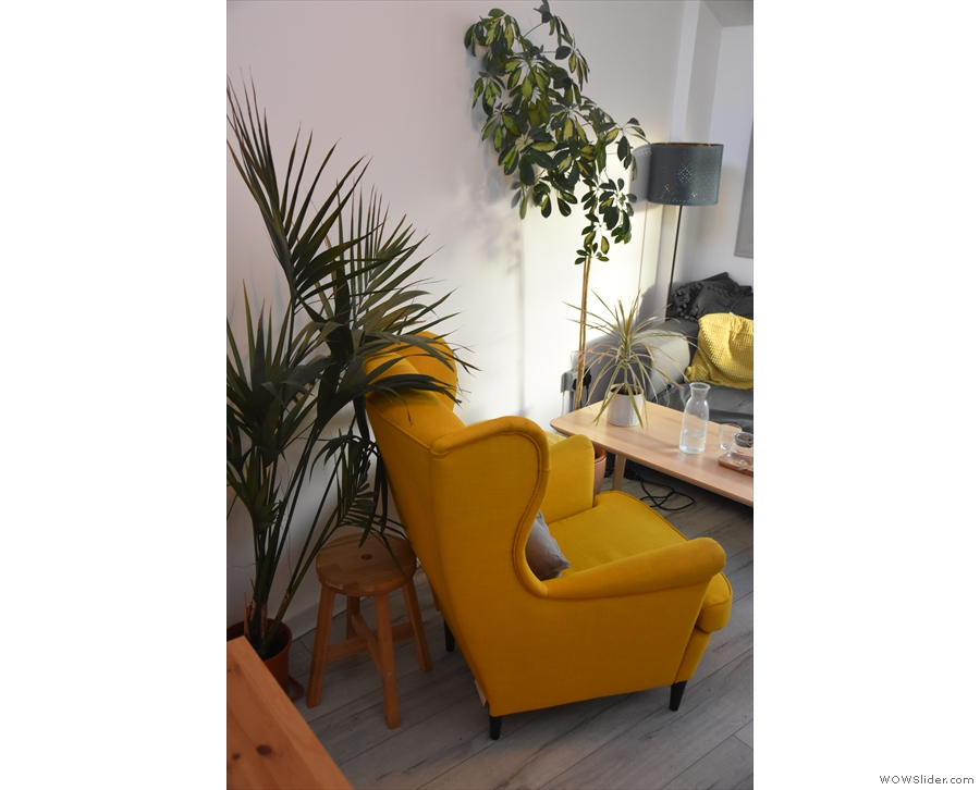 There's more seating at the back, starting with this armchair against the left-hand wall...