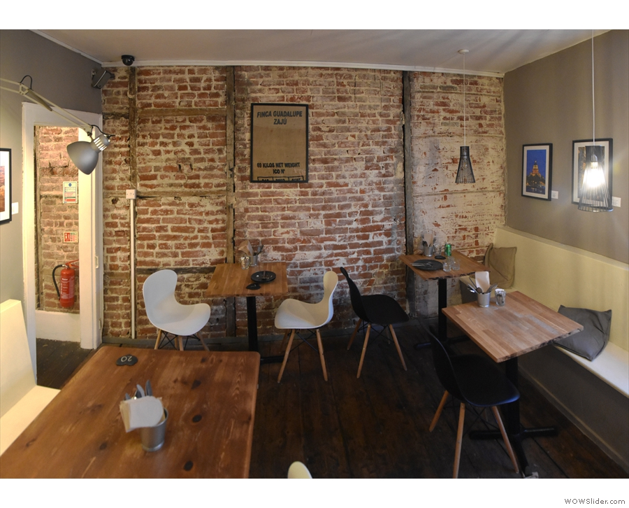 Finally, there's another two-person table against the exposed brick of the right-hand wall.