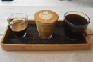 April: trying the coffee flight at Toro Coffee.