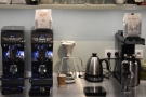 The two espresso grinders, plus the batch-brewer and pour-over set-up are at the back.