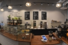 A view of the counter from side on. Standing here, the retail shelves are on the wall....