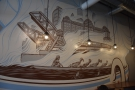 The mural above is fascinating, showing scenes from the Chicago River, painted as if in a...