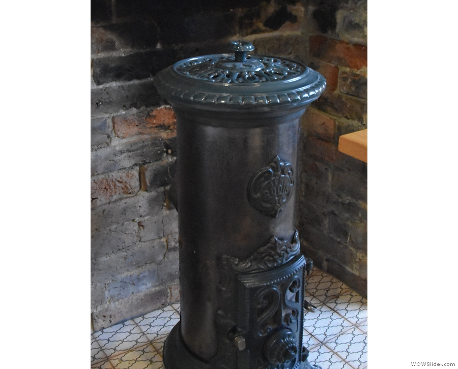 Check out this awesome old stove in the fireplace. Sadly I don't think it's in use.