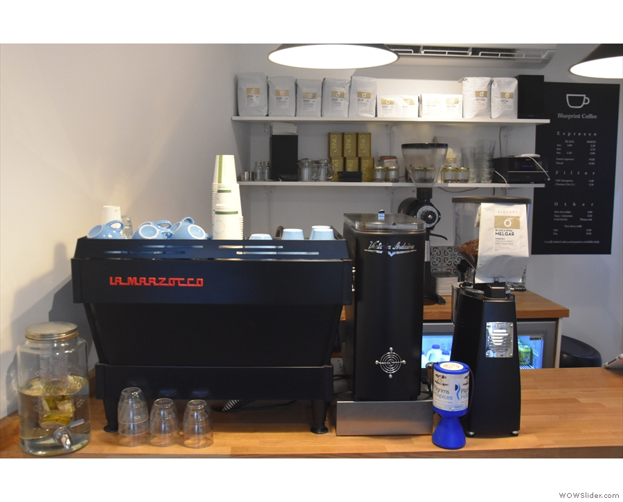 Down to business. The espresso machine and its two grinders are on the left...