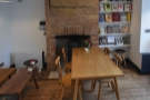 Next to this, in front of the fireplace in the right-hand wall, is this four-person table...