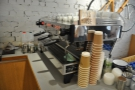 The espresso machine, a three-group La Marzocco Linea, is off to the right...