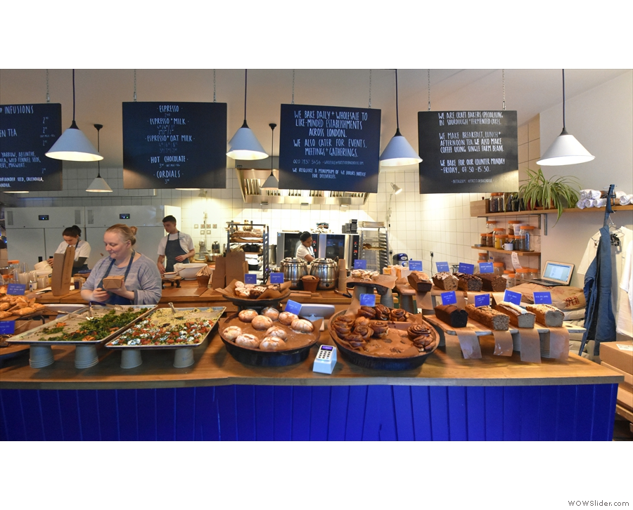 The counter runs the full width of the store, menu and information boards hanging above.