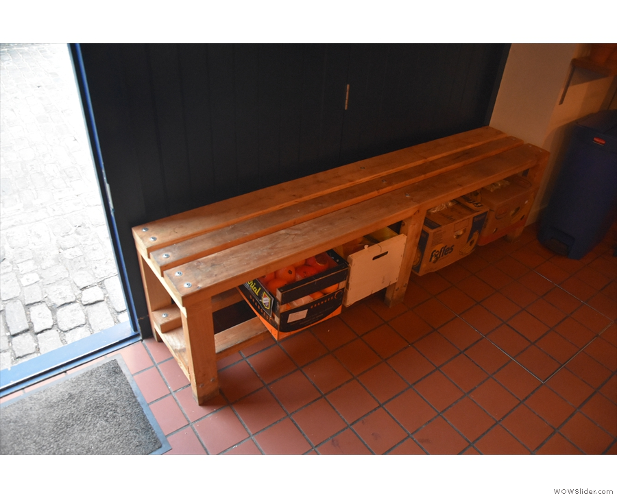 ... and under the bench by the door. Check out the tiled floor, by the way.