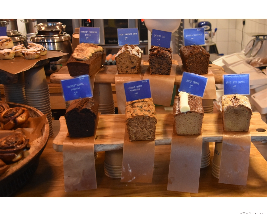 The bakery's output, displayed on the counter, starts with various sweet loaves.