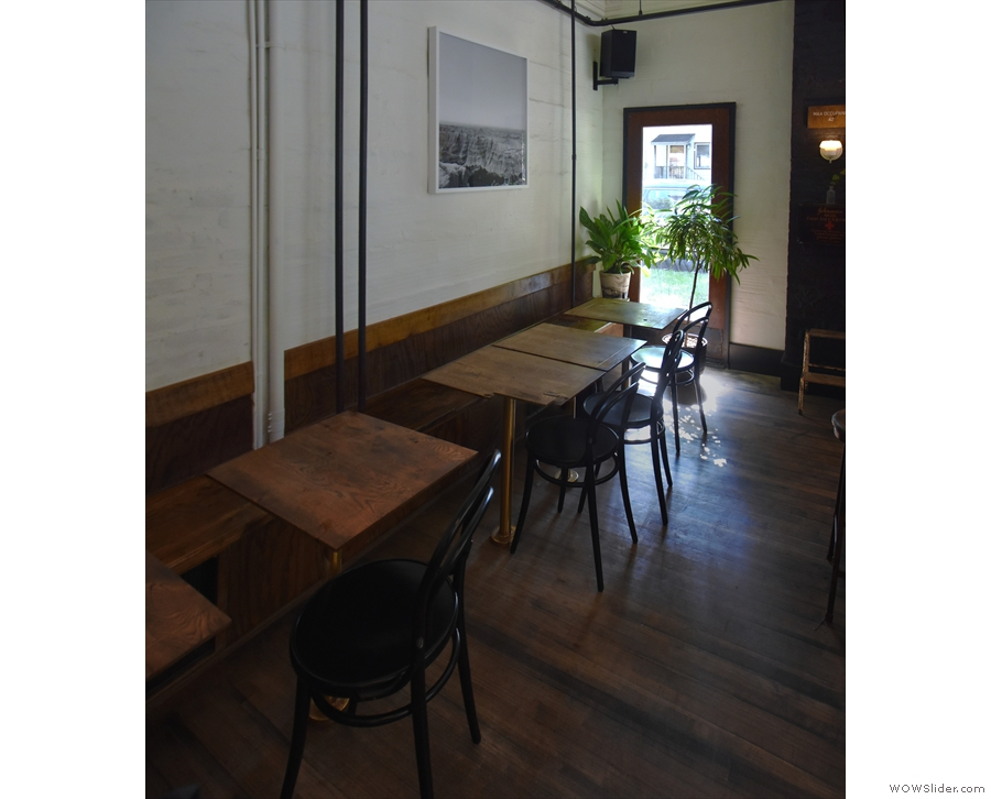 Finally, there are another eight of the narrow, two-person tables along the back wall.