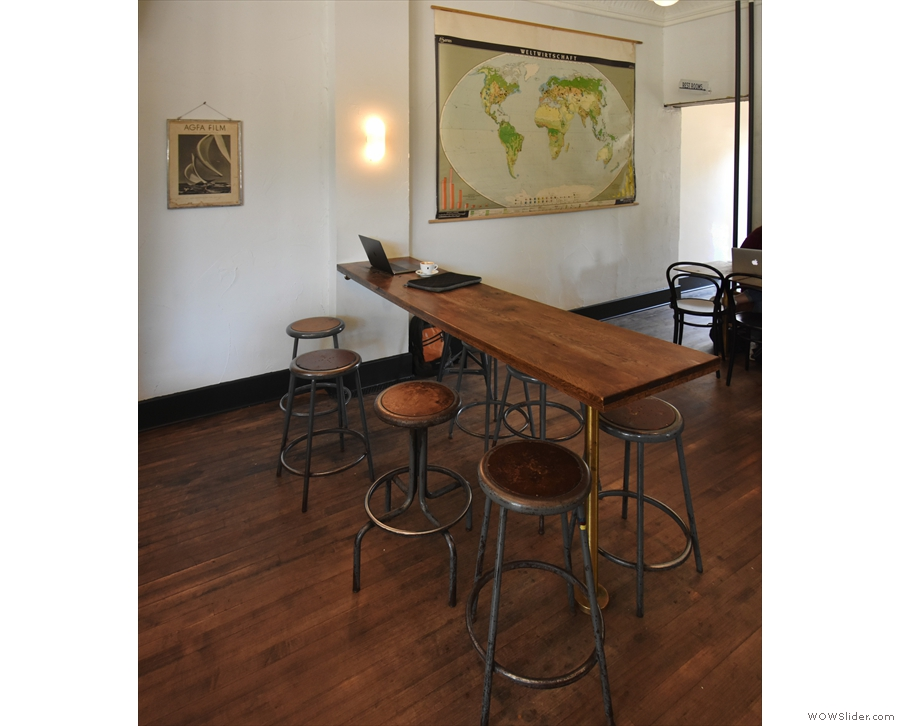 ... where you'll find this high, thin, eight-person communal table.