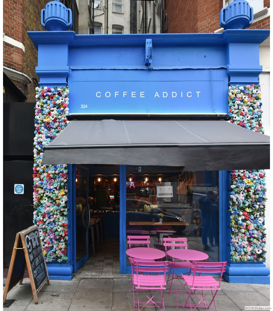 Coffee Addict, a small, striking space, with flower-decked walls & lighting to match
