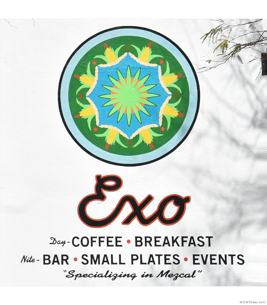 Exo Roast Co., all classic exposed brick and wood, with gloriously high ceilings.