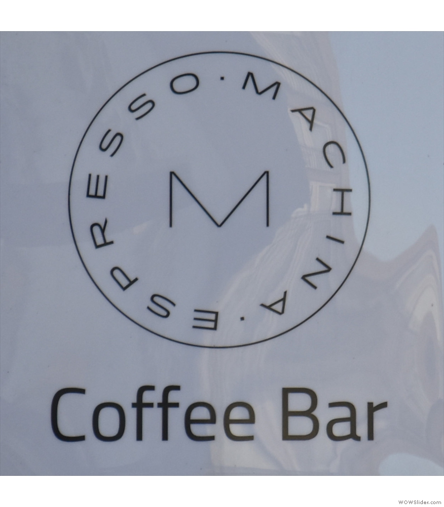 Machina Espresso, Nicolson Street, cleverly broken up with scaffolding-style shelving units.