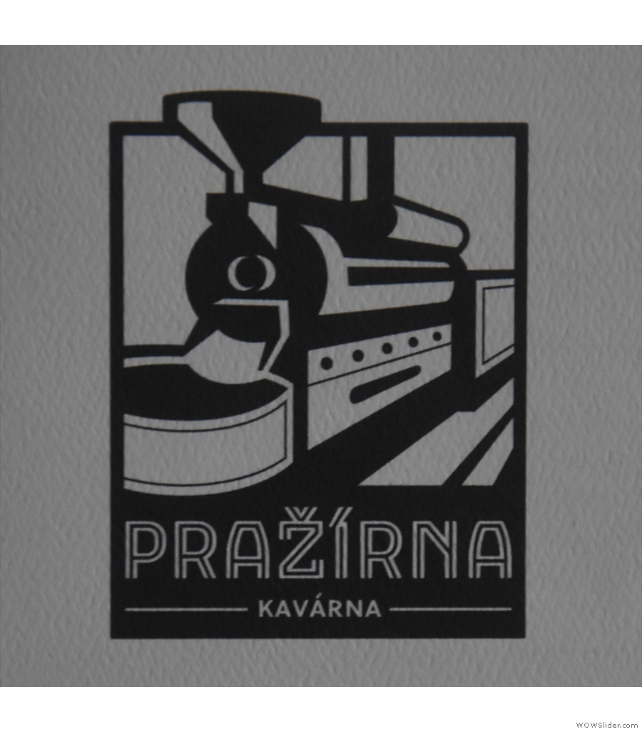 Pražírna Kavárna, with exposed brick walls and vaulted ceilings across multiple rooms.