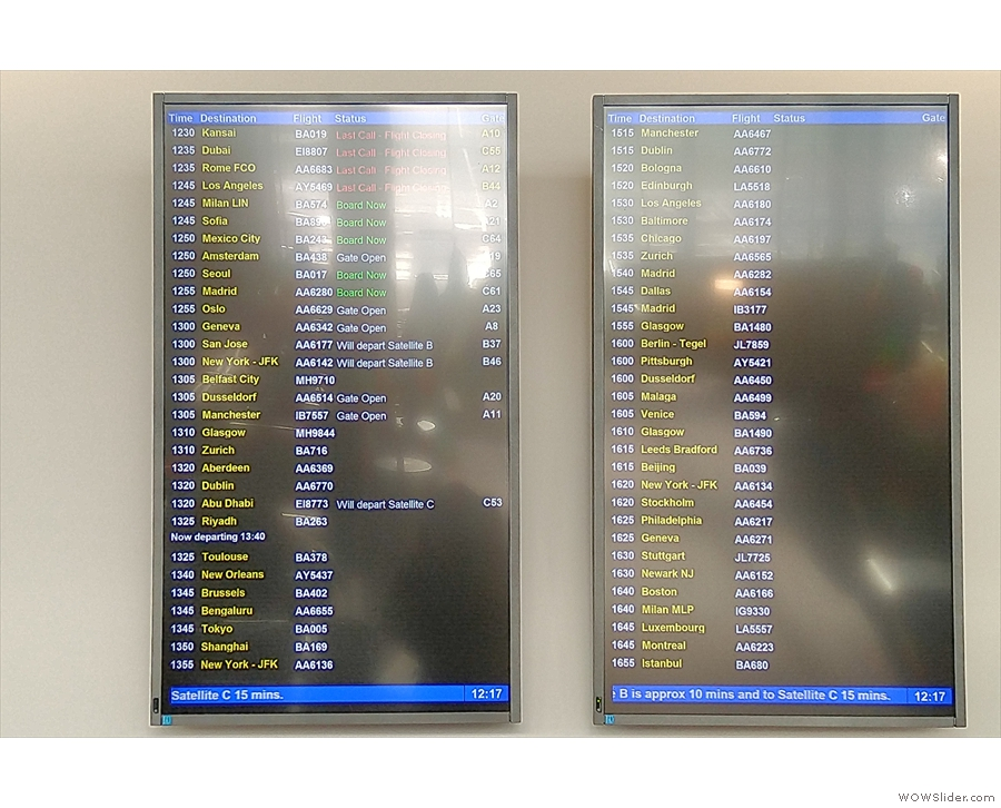 There are departure boards on the wall back here, so you can keep an eye on your flight.
