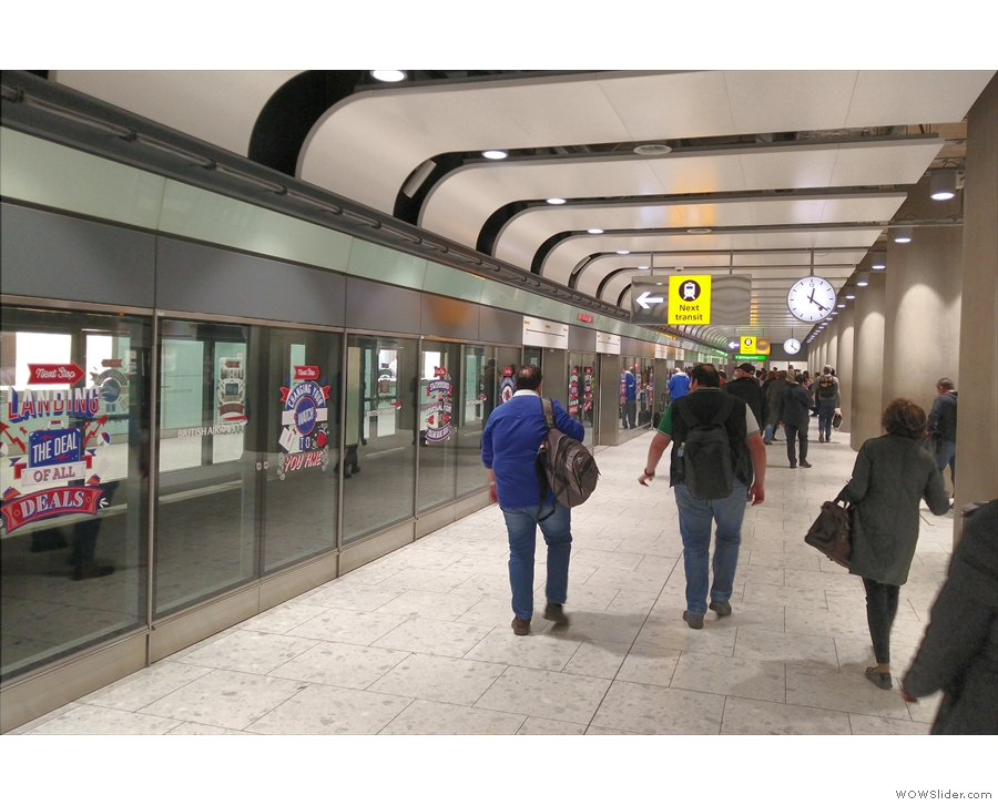 ... escalators and catch the transit, a little underground train that runs to B and C gates.
