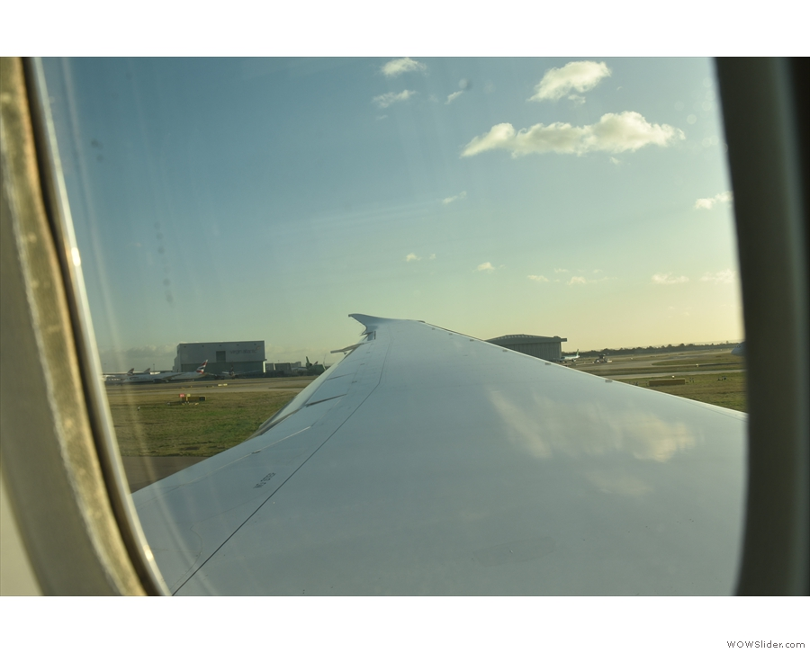 Now it's our turn. We trundle down the runway, taking off...
