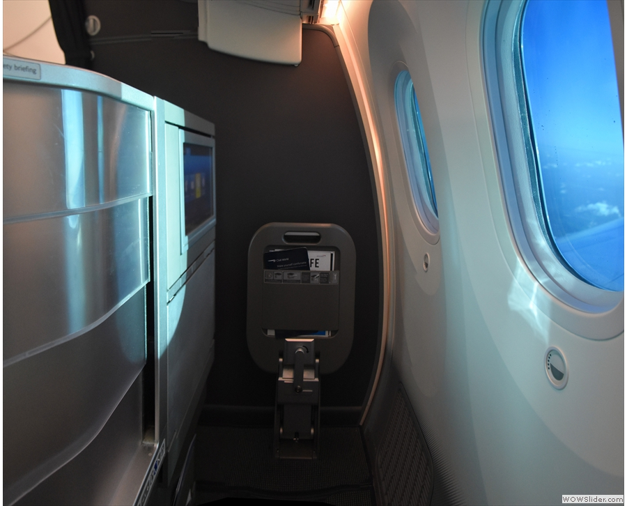 This is the bulkhead seat at the back on the left: privacy, access and three windows...