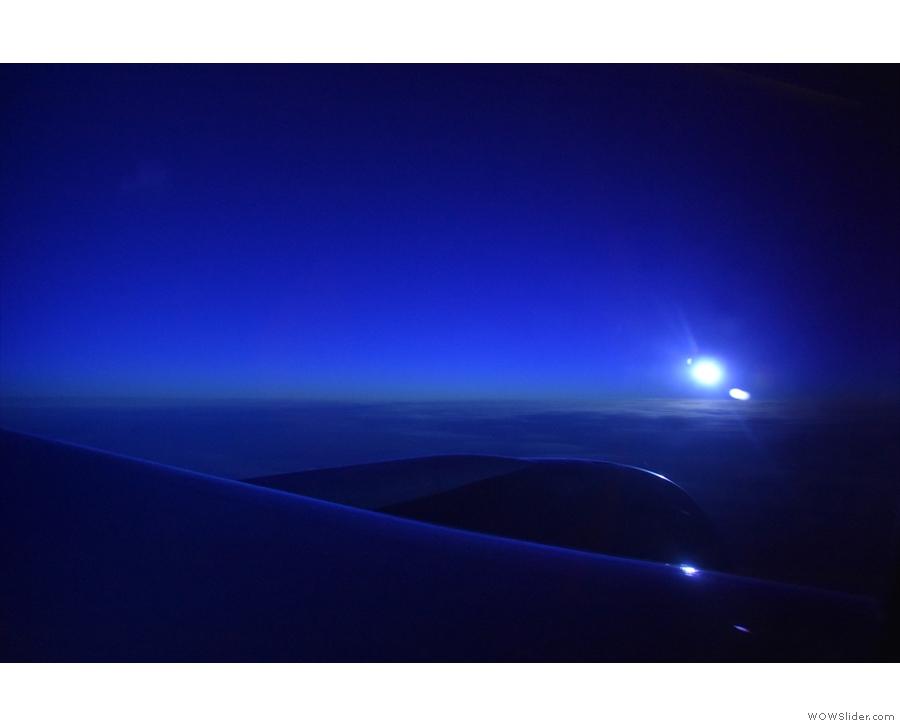 ... wth the sun outside approaching the horizon.