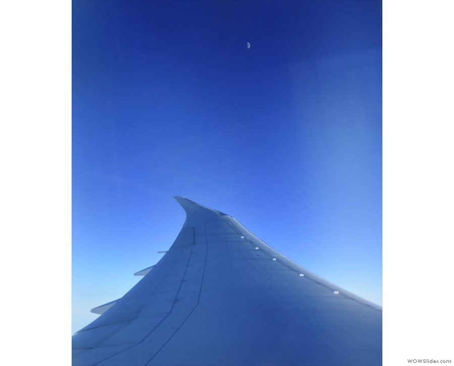 ... although over the tip of the wing, I could see the moon.