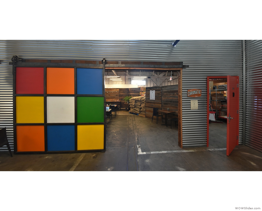 The spot being the Rubix Cube themed sliding door, which leads to the coffee shop.