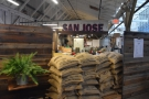 ... which continues to the left, where a pile of coffee sacks lets you see the roastery.