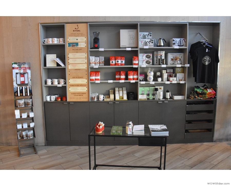 The retail shelves occupy a good chunk of the wall between the window and counter.