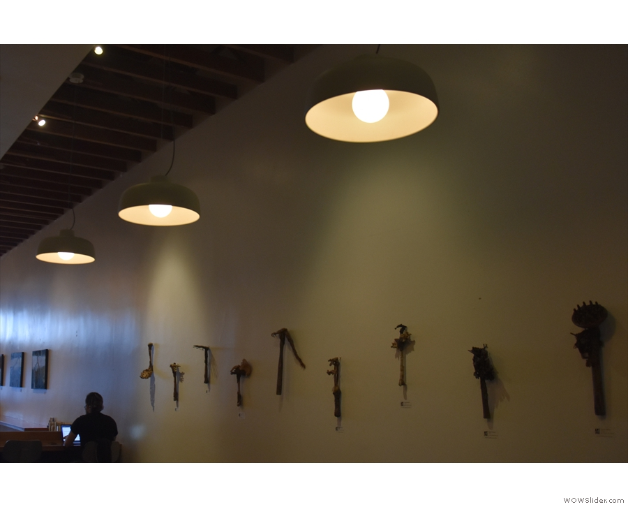 The interior decor of Ritual is minimalist, broken only by art displays on the left-hand wall.