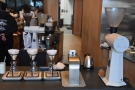 The pour-over section, with its V60s and EK43 grinder, is at the front of the counter.