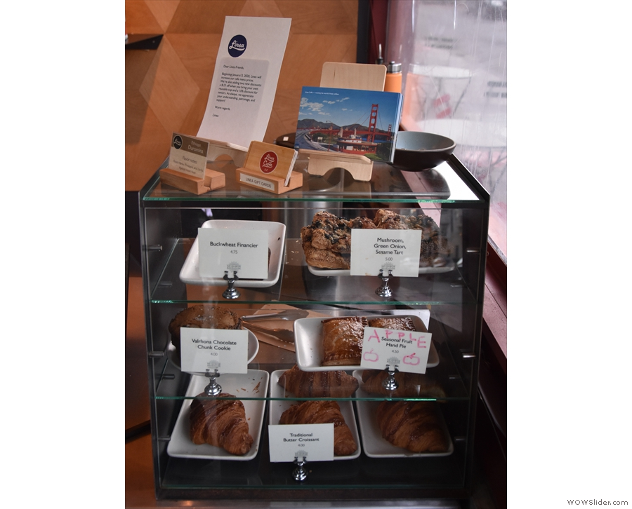 On the other side of the till are these cakes and pastries, including some savoury items.