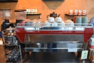 It's dominated by the new La Marzocco KB90 espresso machine. Shiny!