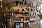 The retail shelves which separate the counter from the seating are a treasure-trove of...
