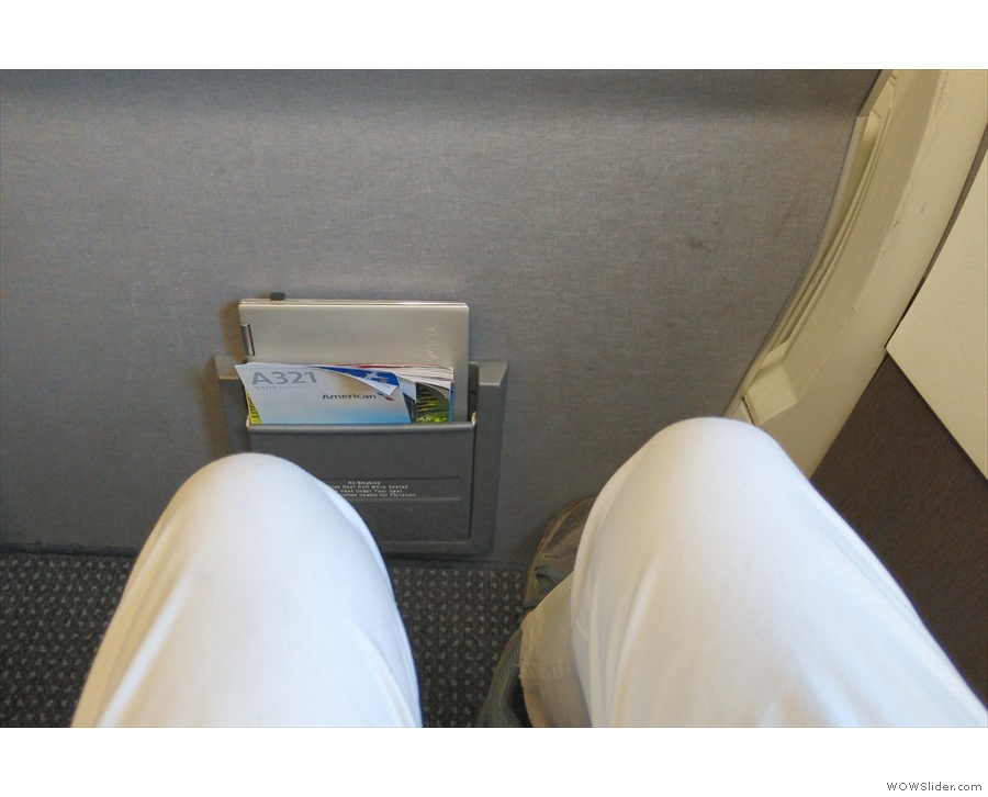 There's plenty of legroom, and I can get my laptop in the magazine pocket.