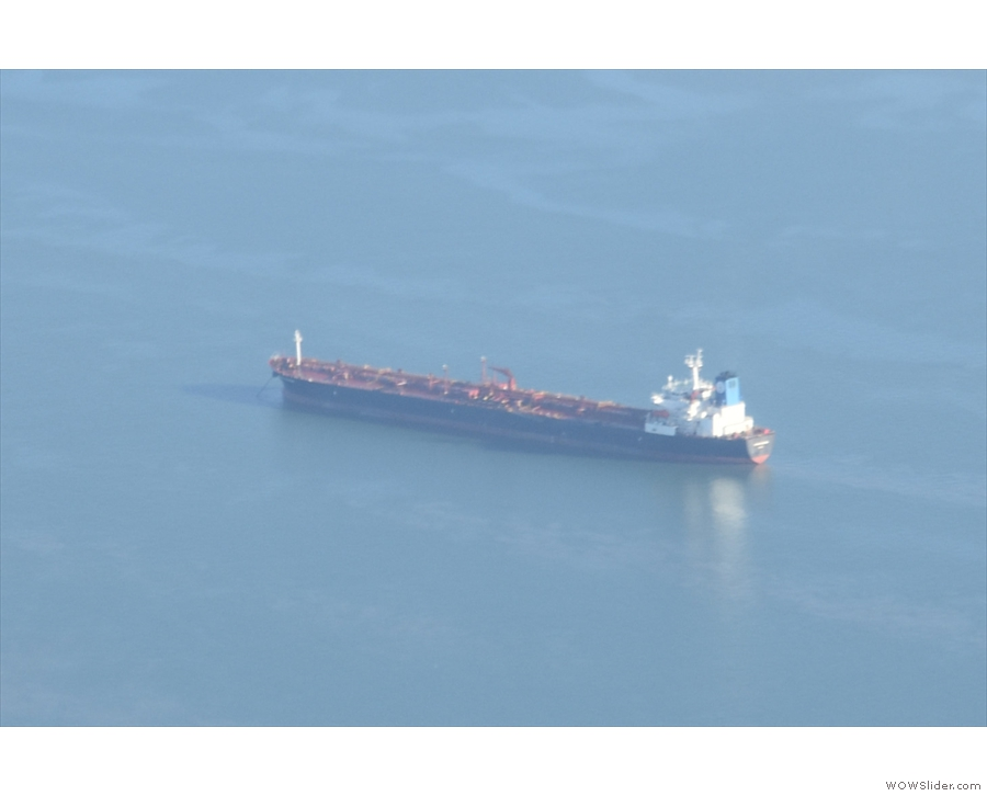 One of the many ships down below in the bay, probably heading to/from...