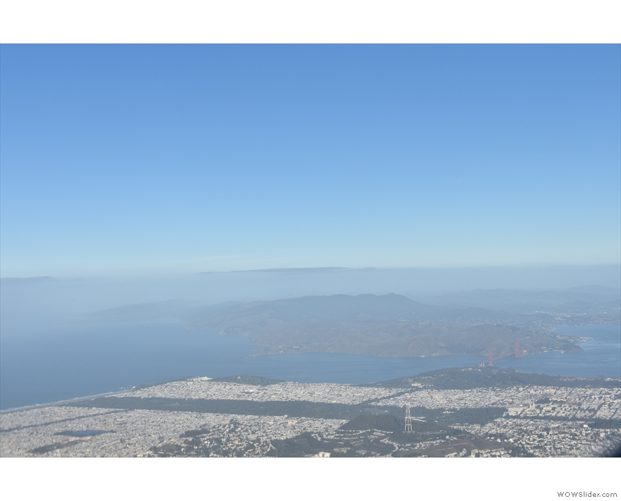 ... flying south of the Twin Peaks with the Golden Gate Park and Presidio in the distance...